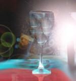 Brujería con una copa de agua